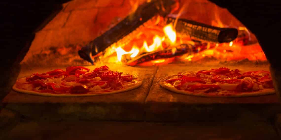 A traditional Italian wood-fired brick oven for cooking Neapolitan pizzas