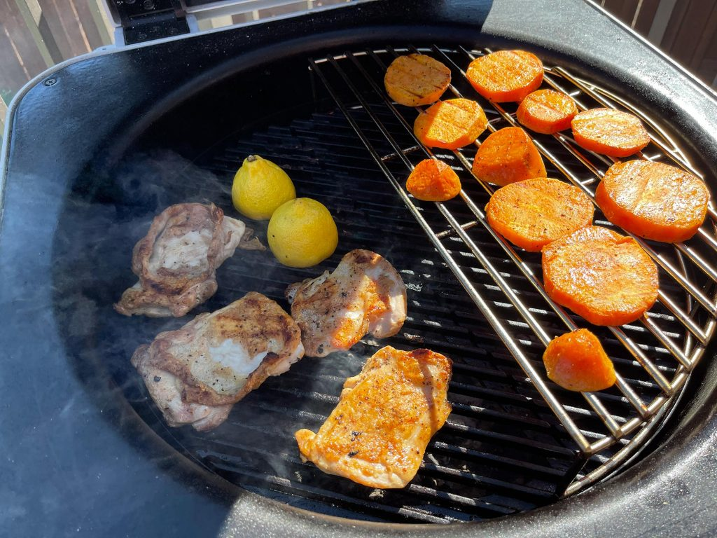 Chicken thighs and sweet potatoes cooked on the Everdure 4K.
